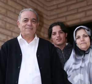 Ahmed, with his parents